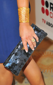 Adrienne Maloof accessorized with a stunning gold lattice cuff bracelet at the Critics' Choice Television Awards.