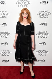Christina Hendricks went for easy elegance in a Dolce & Gabbana LBD with contrast stitch detail at the New York premiere of 'Crooked House.'