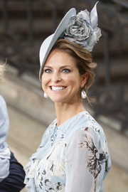 Princess Madeleine polished off her look with a pair of pearl drop earrings.