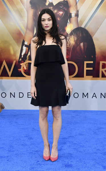 Crystal Reed Strapless Dress [premiere of warner bros. pictures,dress,clothing,red carpet,shoulder,little black dress,carpet,cocktail dress,premiere,hairstyle,fashion,wonder woman,crystal reed,arrivals,california,hollywood,pantages theatre,warner bros. pictures,premiere]