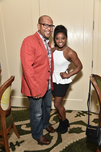 Simone Biles paired her top with a black mini skirt.