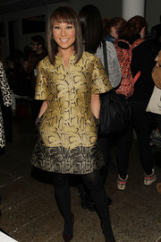 Alina Cho walked on the wild side in a gold and black snakeskin-print dress during the Cushnie et Ochs fashion show.