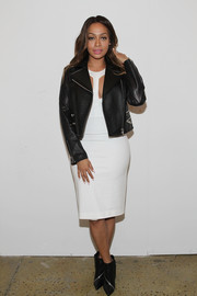 La La Anthony was sexy-edgy at the Cushnie et Ochs fashion show in a black leather jacket layered over a white cutout dress.