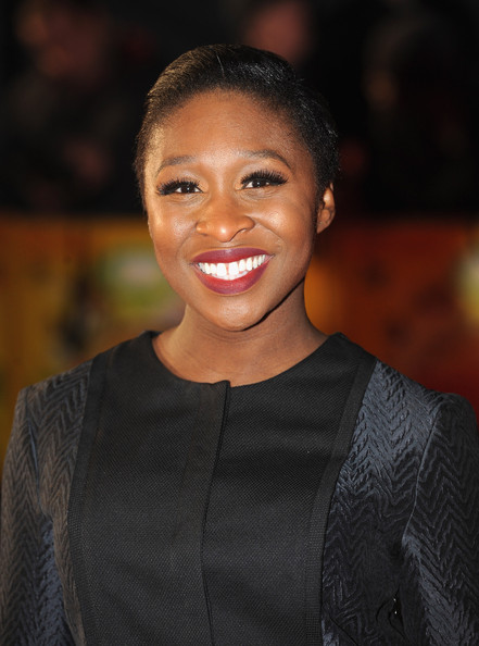 Cynthia Erivo Fauxhawk [the harry hill movie,face,hair,facial expression,smile,eyebrow,beauty,hairstyle,head,lip,chin,world premiere - inside arrivals,cynthia erivo,england,london,vue leicester square,world premiere]