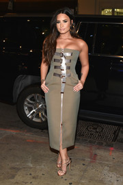 Demi Lovato went for a glam finish with a pair of strappy gold heels by Stuart Weitzman.