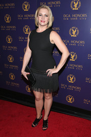 Melissa Joan Hart went for a flirty vibe in a fitted LBD with a fringe skirt during the DGA Honors.