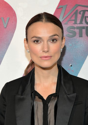 Keira Knightley sported a simple center-parted ponytail while visiting DIRECTV House.