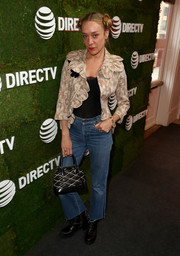 Chloe Sevigny went rugged on the bottom half in a pair of frayed bootcut jeans.