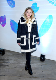Sydney Sweeney cozied up in a navy and white fur coat at the 'Big Time Adolescence' party at Sundance.
