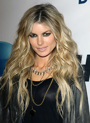 Supermodel Marisa Miller showed off her long voluminous locks at a Super Bowl party.