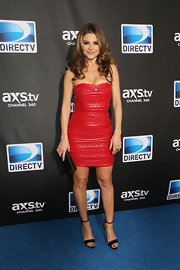 Maria paired her red leather dress with a black satin clutch.