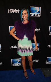 Katy Perry topped off her colorful ensemble with metallic color-blocked sandals.