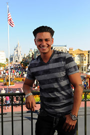 Paul visited Disney World where he showed off his cool style in a striped t-shirt.