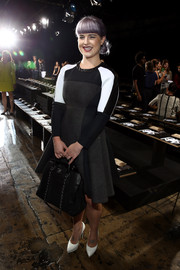Kelly Osbourne's long-sleeve tricolor dress at the DKNY fashion show had a stylish futuristic feel.