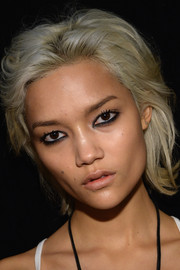 Charlotte Carey rocked a bleached layered razor cut during the DKNY fashion show.