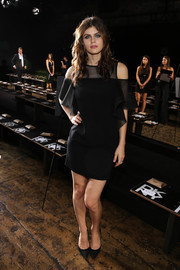 Alexandra Daddario oozed a modern vibe at the DKNY fashion show in a sheer-panel LBD with drop sleeves.