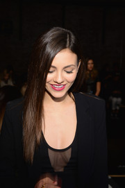 Victoria Justice wore her long hair loose with a side part and sleek layers during the DKNY fashion show.