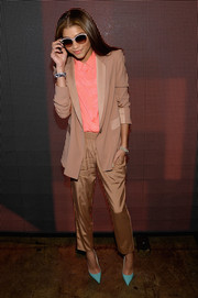 Zendaya Coleman went for some menswear-inspired coolness in a beige pantsuit worn with a coral button-down during the DKNY fashion show.