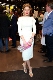 Hofit Golan went for vintage elegance in a white sheath dress with a foldover neckline during the Dsquared2 London flagship opening.