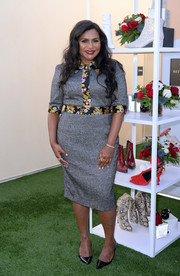 Mindy Kaling kept it classy in a gray Dolce & Gabbana midi dress with floral trim at the DSW Gives Do Good Pop-Up event.