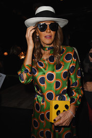 Anna dello Russo topped off her eclectic ensemble with a black-and-white straw hat.