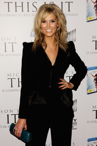 """Delta Goodrem showed up at the """"This Is It"""" DVD launch in a sleek velvet suit. Her blonde locks looked golden to perfection as she walked the red carpet."""