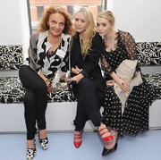 Mary Kate Olsen added a pop of color to her all black attire with Miu Miu's red and black lace-up ankle boots.