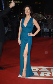 Catherine Zeta-Jones looked ageless at the world premiere of 'Dad's Army' in a figure-hugging teal Elie Saab gown with a plunging neckline and a thigh-high slit.