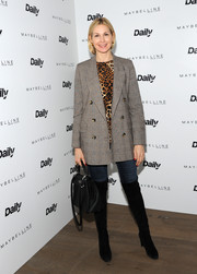 Kelly Rutherford styled her casual look with black over-the-knee boots.