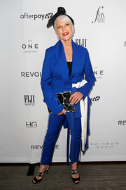 Maye Musk styled her suit with bejeweled black slingbacks.