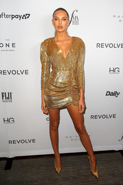 Romee Strijd gleamed in a gold sequined wrap dress by Retrofete for FWRD at the 2019 Fashion Media Awards.