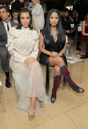 Kim Kardashian contrasted her frilly dress with simple nude platform sandals when she attended the Fashion Los Angeles Awards.
