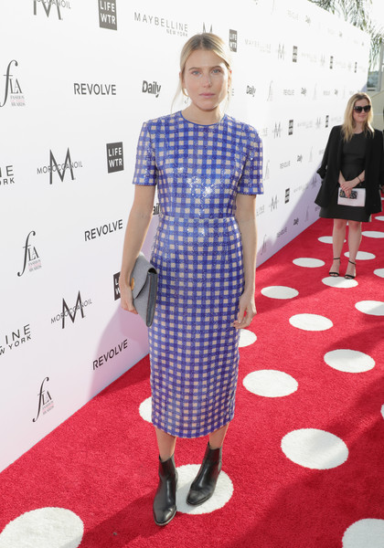 Dree Hemingway toughened up her dress with a pair of black chelsea boots.