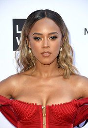 Serayah McNeill wore her hair in shoulder-length waves at the 2018 Fashion Los Angeles Awards.
