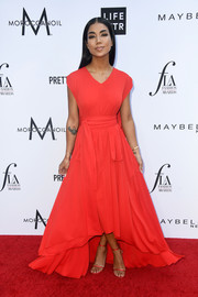 Jhene Aiko went for ladylike glamour in a red Céline gown with a high-low hem at the 2018 Fashion Los Angeles Awards.