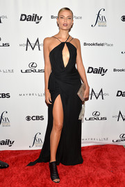 Natasha Poly contrasted her sultry gown with edgy open-toe booties.