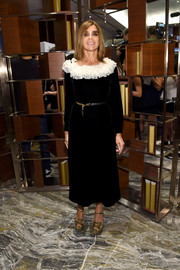 Carine Roitfeld opted for a black Saint Laurent frock with a contrasting white ruffle collar for her Fashion Media Awards look.