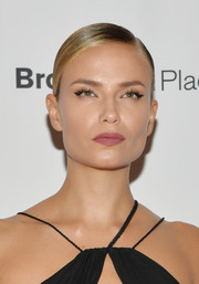 Natasha Poly looked elegant wearing this sleek side-parted chignon at the Fashion Media Awards.