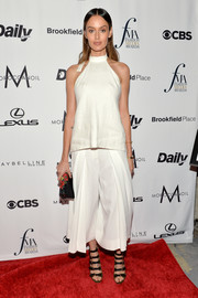 Nicole Trunfio was casual on the Fashion Media Awards red carpet in a plain white halter top.