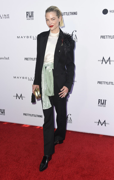 Jaime King teamed her suit with a pair of black leather slip-ons.