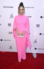Cara Santana was Barbie-glam in a pink cape-sleeve gown by Solace London at the 2019 Fashion Los Angeles Awards.