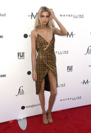 Stella Maxwell styled her frock with strappy gold heels by Gianvito Rossi.