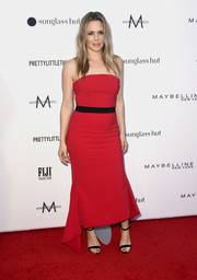 Alicia Silverstone kept it simple and classic in a strapless red gown by Christian Siriano at the 2019 Fashion Los Angeles Awards.