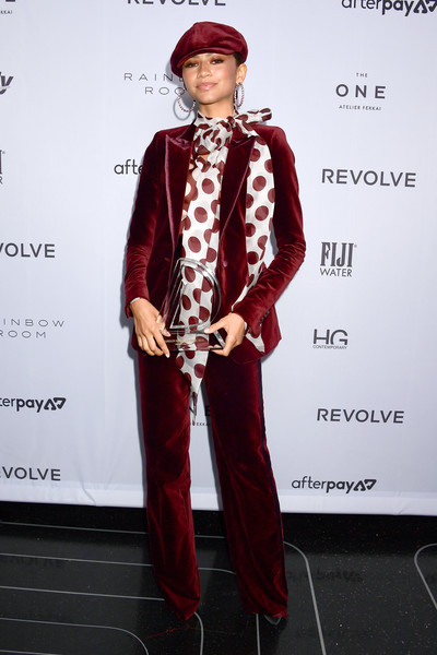 Zendaya Coleman rocked a wine-red velvet pantsuit from her collab with Tommy Hilfiger at the 2019 Fashion Media Awards.