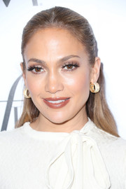 Jennifer Lopez dolled up her look with a pair of diamond and gold hoops.