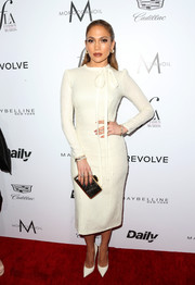 Jennifer Lopez went modest in a long-sleeve white tie-neck dress by Ermanno Scervino for the Fashion Los Angeles Awards.