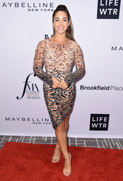 Aly Raisman turned up the heat in a sheer, embellished ombre dress at the Daily Front Row's Fashion Media Awards.