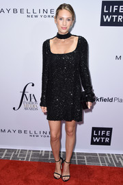 Dylan Penn donned a beaded choker-detail LBD for the Daily Front Row's Fashion Media Awards.