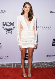 Kaia Gerber paired her cute frock with silver ankle-strap sandals.