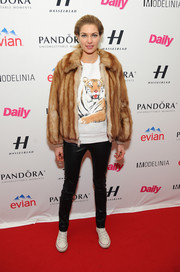 Jessica Hart mixed glamour with edge with this tan fur jacket and leather skinnies combo at the Models Issue party.
